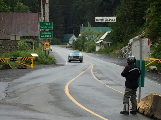 """Although not a good photo, I just had to show this. Rick was reprimanded by the Canadian Boarder Guard for walking away from his bike """"during an investigation"""""""