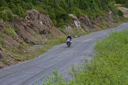 Rick on chip seal road along Salmon Glacier